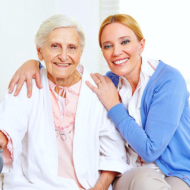 caregiver holding senior woman shoulder
