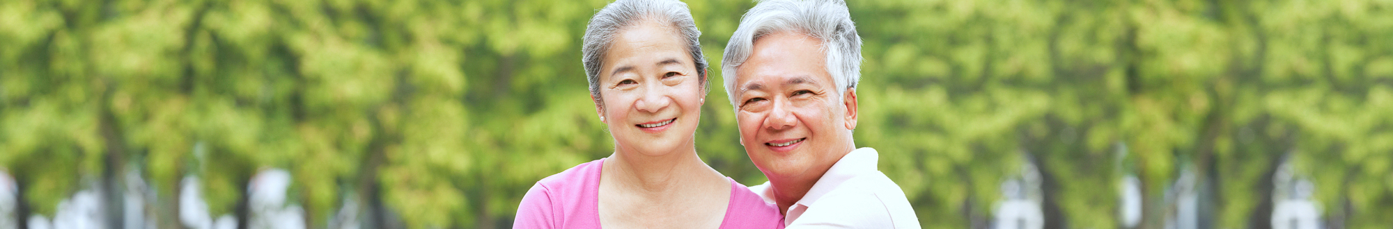 senior couple both smiling