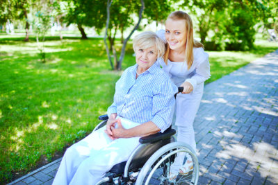caregiver and senior woman going for walk